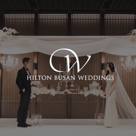 """<h6 style=""""text-align: center;""""><strong><span style=""""font-size: 16px;"""">Hilton Busan Weddings</span></strong> <br><span style=""""font-size: 14px;color: rgb(136, 136, 136);"""">힐튼 부산 </span></h6>"""