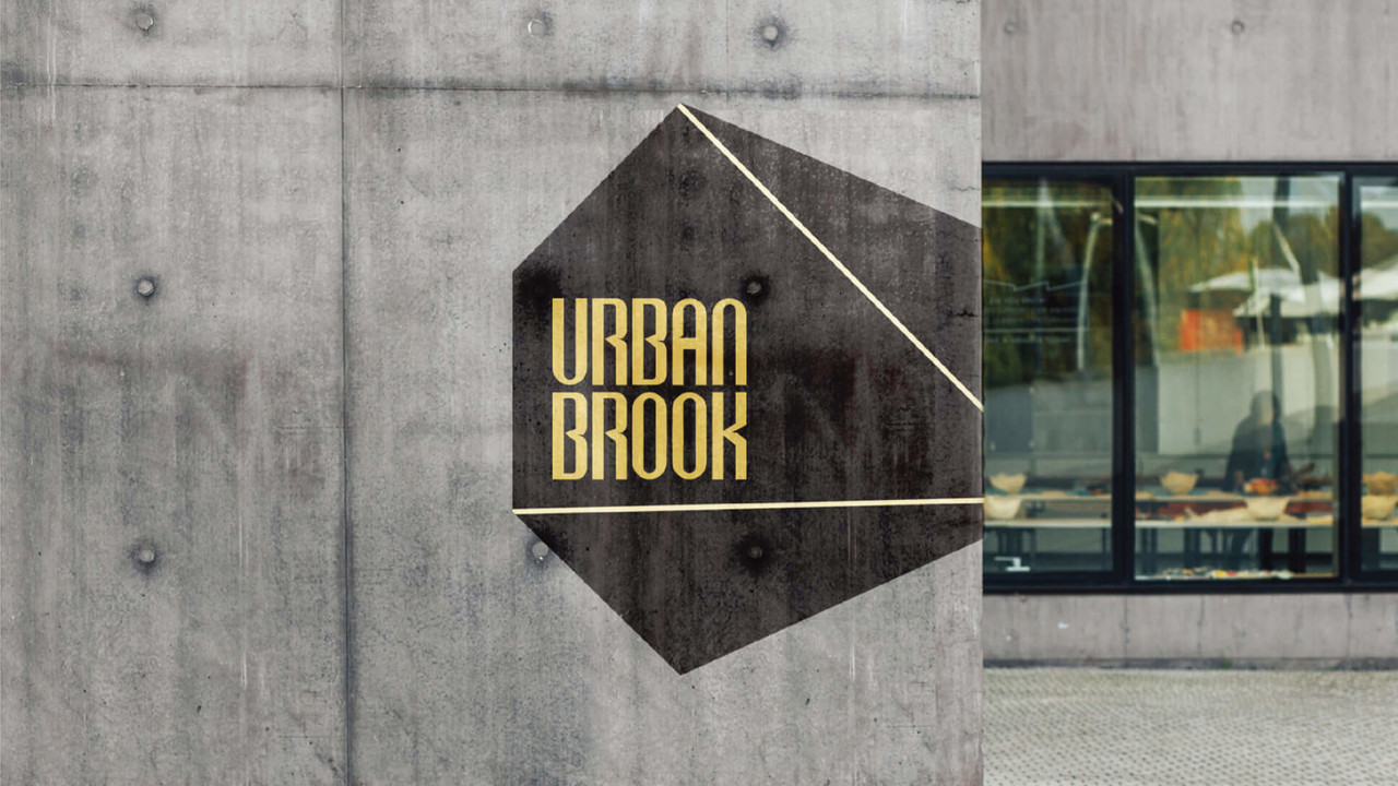 "<i class=""fa fa-angle-left""></i>URBAN BROOK"