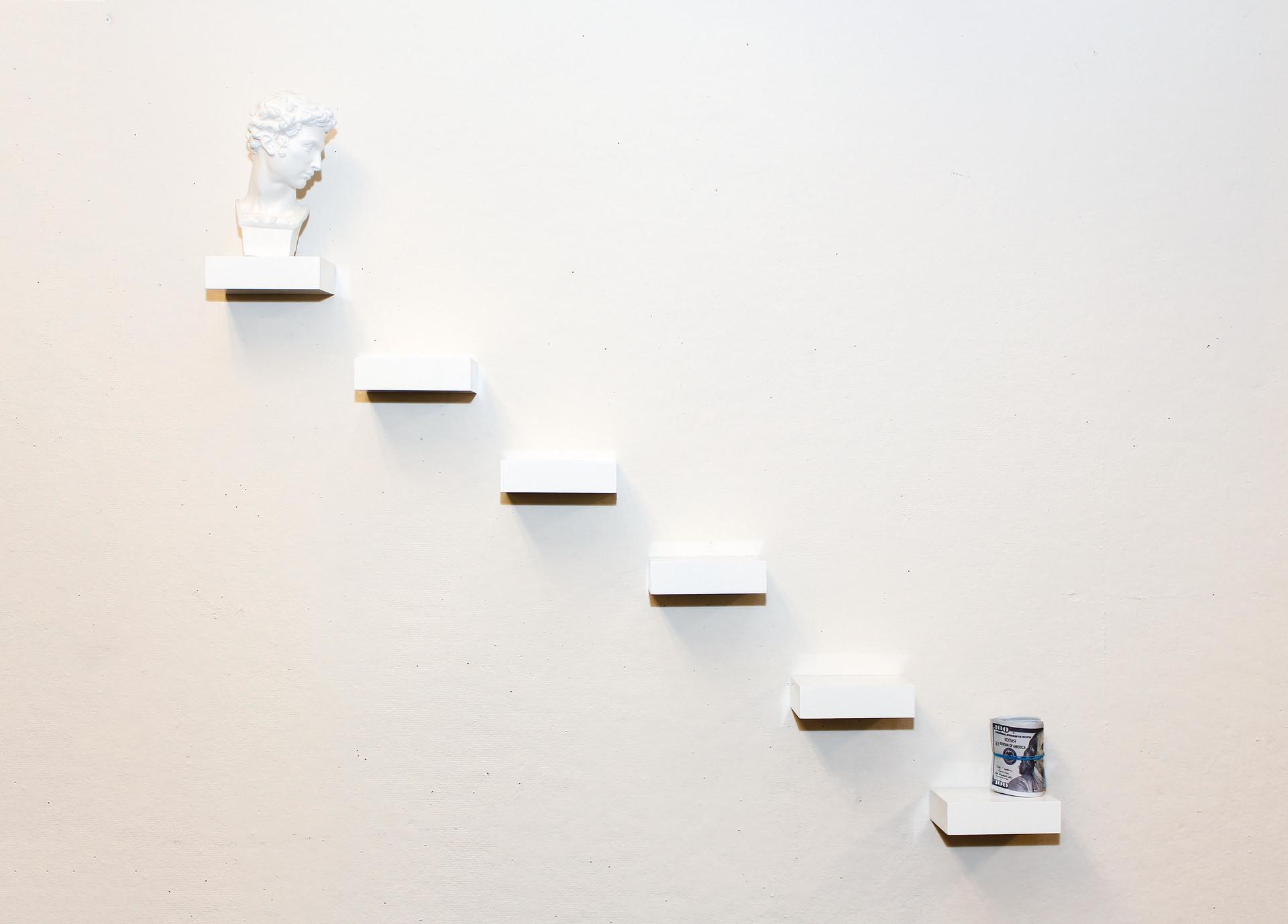 """""""Hierarchy"""" / 2018 / 29inx18inx5in / sculpture head, acrylic squares, money"""