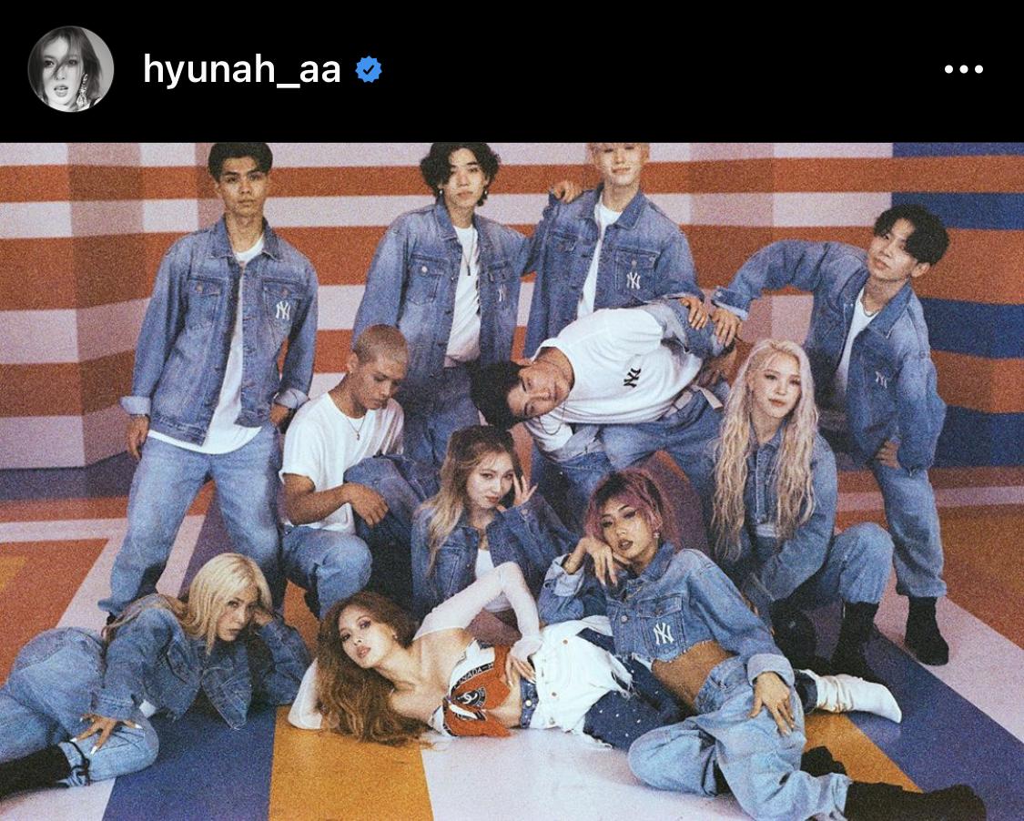 Hyunah wears E-2 white net arms top